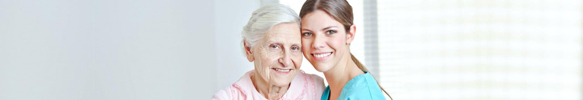 senior and nurse smiling