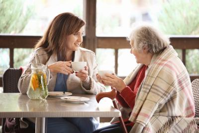 elder woman and caregiver drinking tea