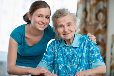 caregiver and elder lady in blue clothing