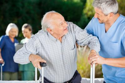 nurses helping senior people